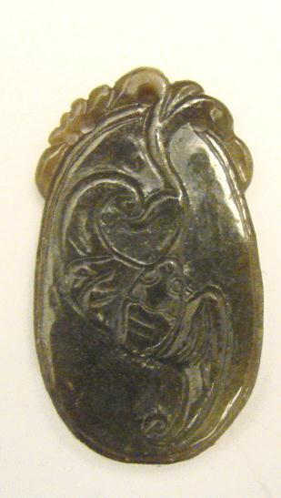CARVED GREEN JADE PENDANT