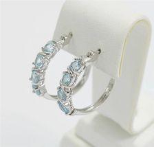 Faceted Blue Topaz Sterling Silver Hoop Earrings - $36.75