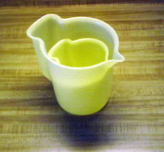 Tupperware yellow pitcher older style vintage tupperware cream pitchers?... - $14.20