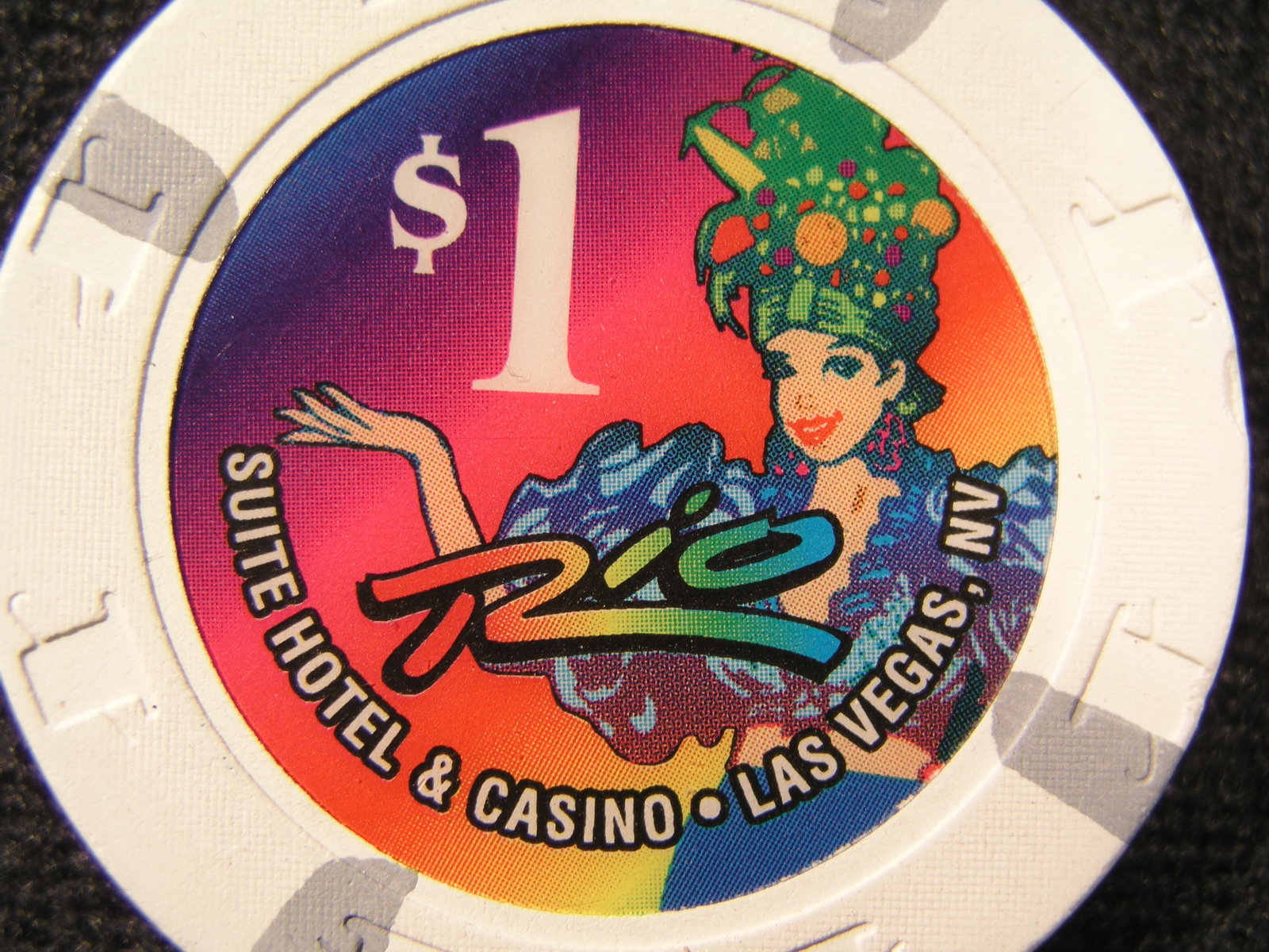 "$1.00 CASINO CHIP FROM:  ""RIO SUITE HOTEL & CASINO"" -  (SKU# 2440)"