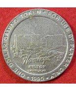 FLAMINGO HILTON $1 SLOT MACHINE TOKEN - LAUGHLIN NEVADA DATED 1990 - $4.99