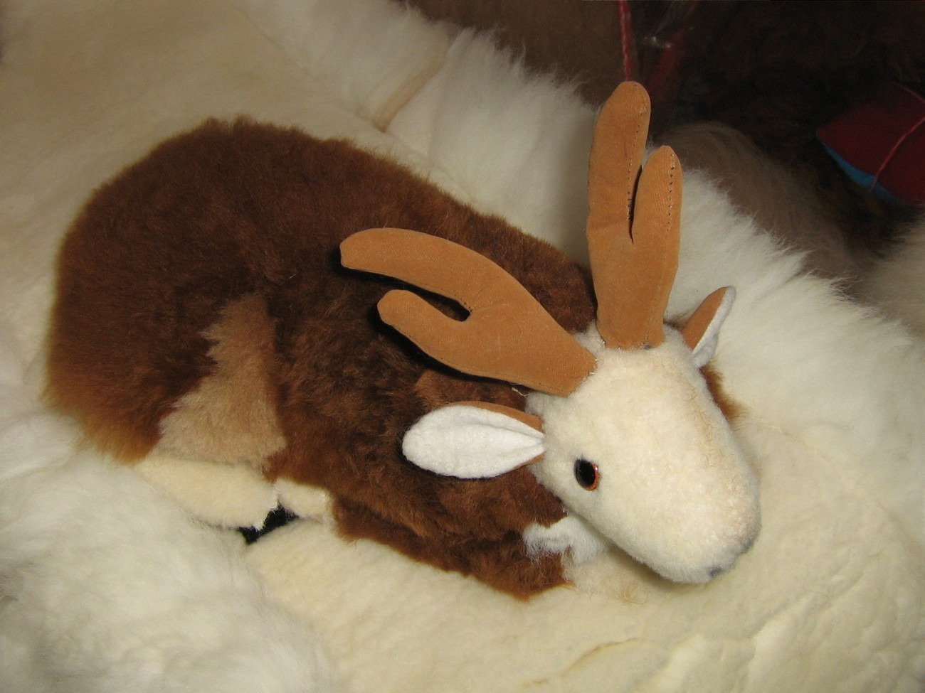 Soft toy Reindeer, figure is handmade with  Alpaca pelt