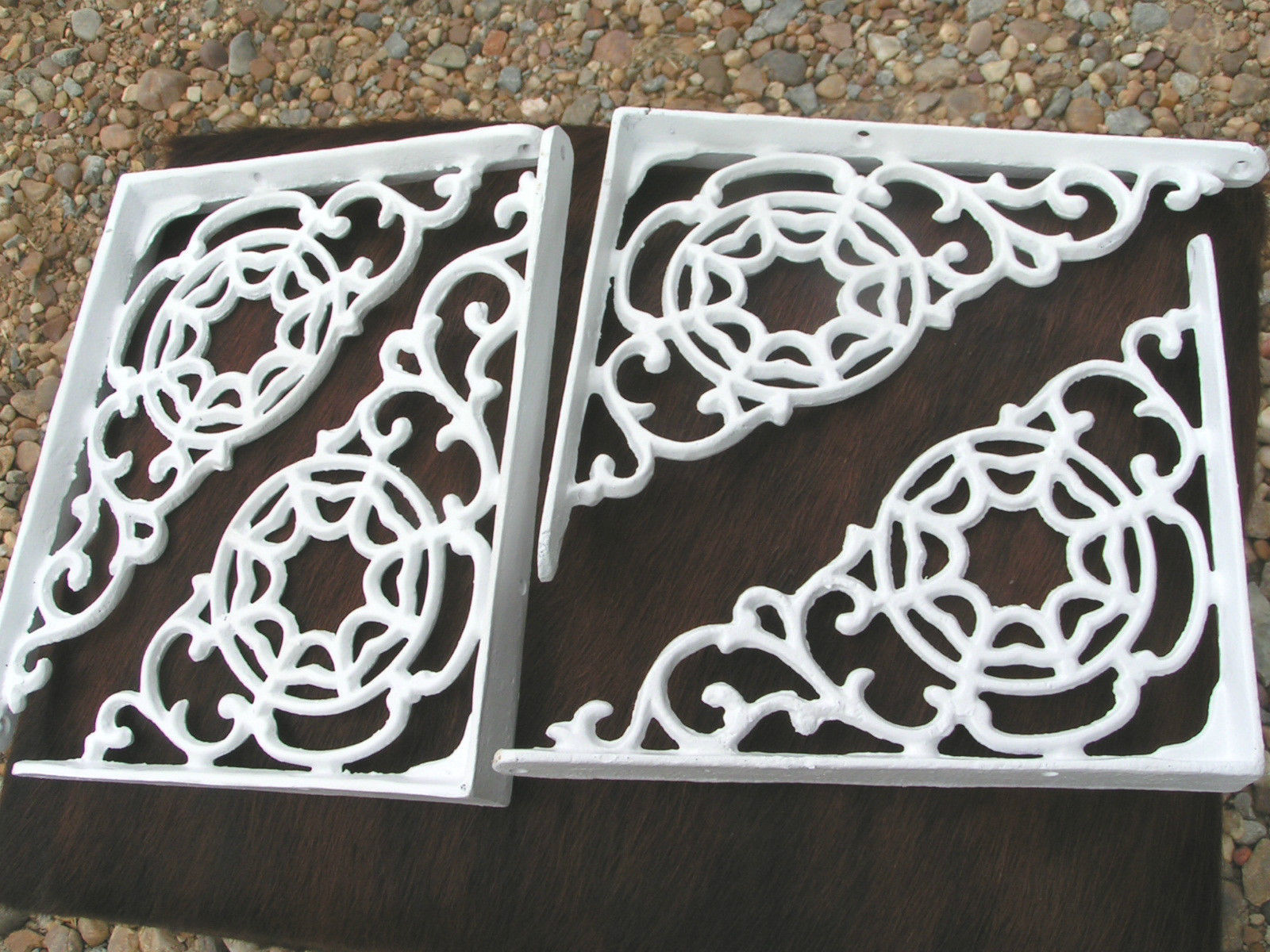 Four white scrolled braces.1 jpg