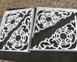 Four white scrolled braces.1 jpg thumb155 crop