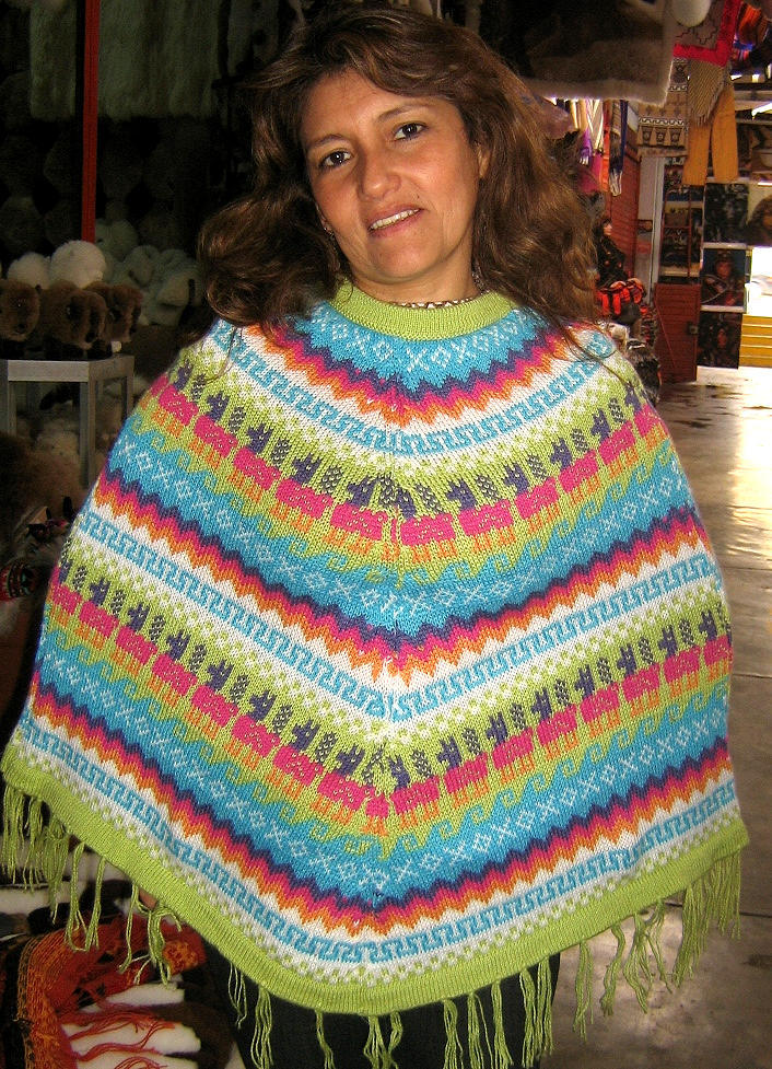 Rainbow colored Poncho made of alpacawool