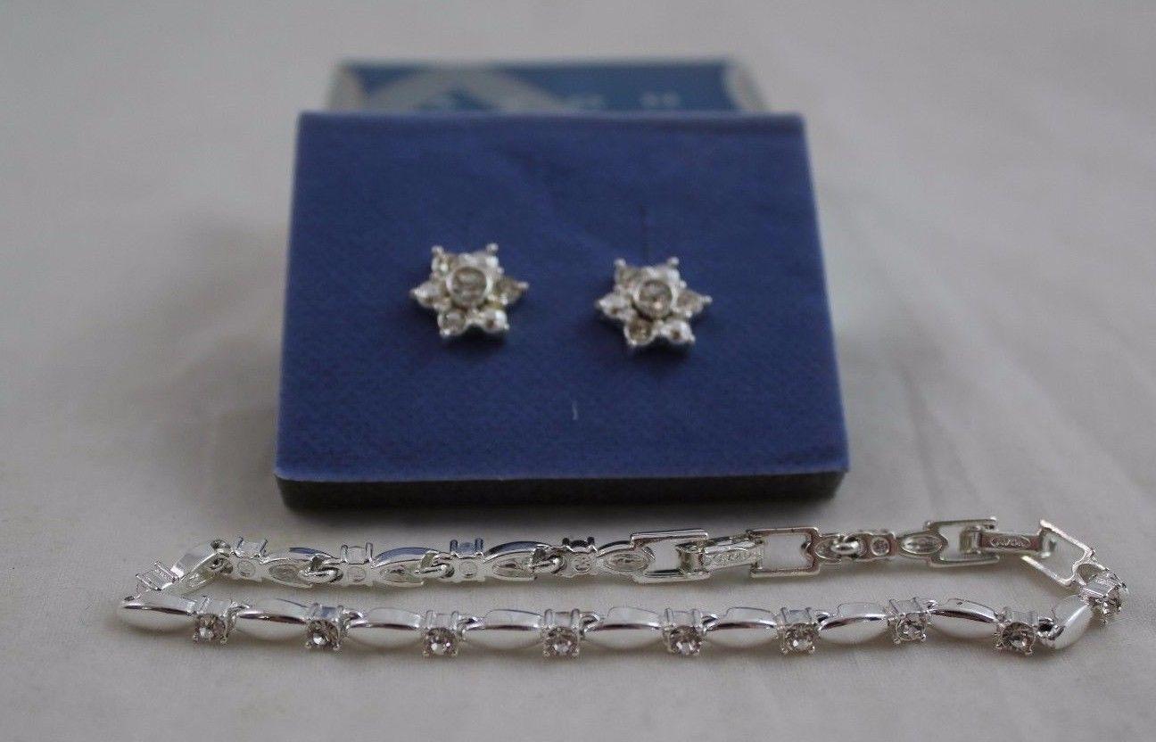 Avon Sparkling Tennis Bracelet And Interchangeable Earring Gift Set Silvertone