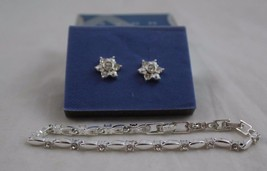 Avon Sparkling Tennis Bracelet And Interchangeable Earring Gift Set Silvertone - $11.99