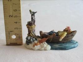 Christmas Village Figurine Man Tied Row Boat Sleeping Bird Albatros Crab... - $19.99