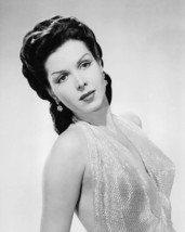 Ann Miller 16x20 Poster in low cut gown - $19.99