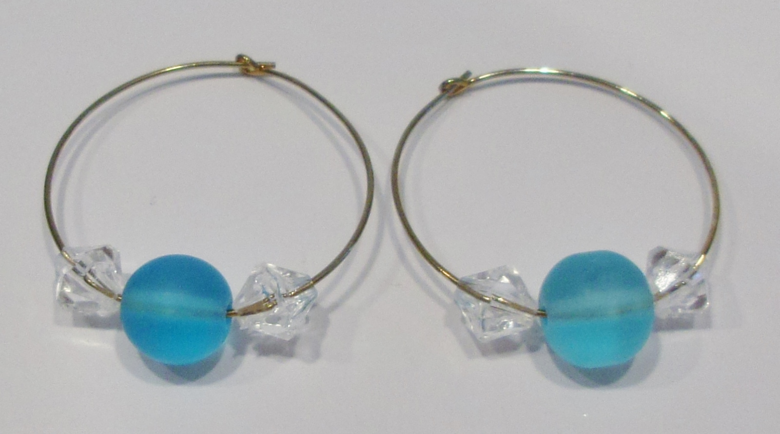 gold hoop earrings with turquoise and clear beads