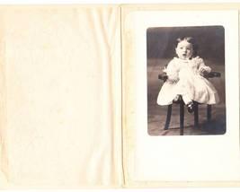 Photo little girl white dress black shoes thumb200