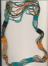 Bohemian Long fancy beaded necklace. Most unusual. Most appealing ! - $18.95