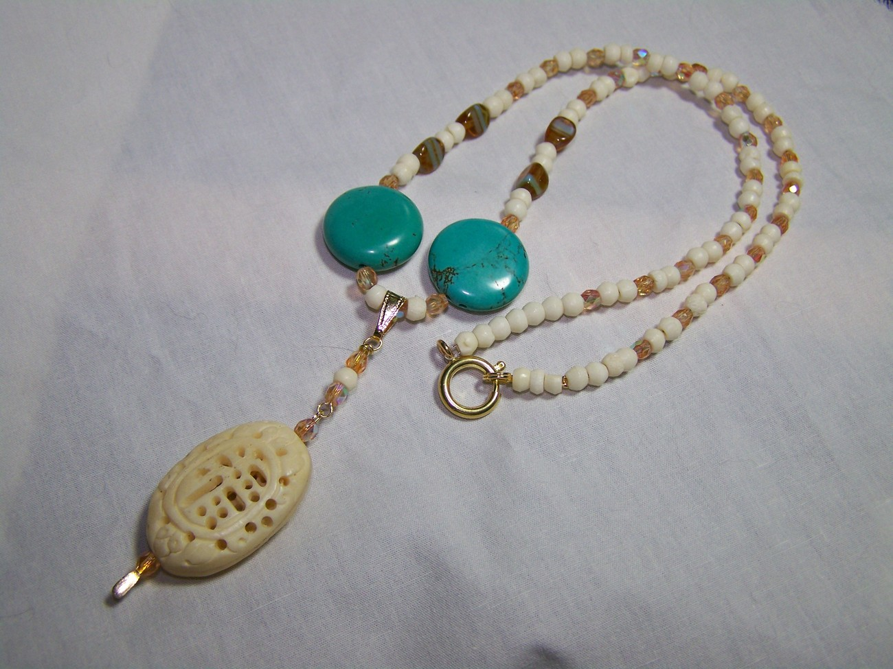 Bone turquoise glass 19 1/2 inch carved pendant necklace