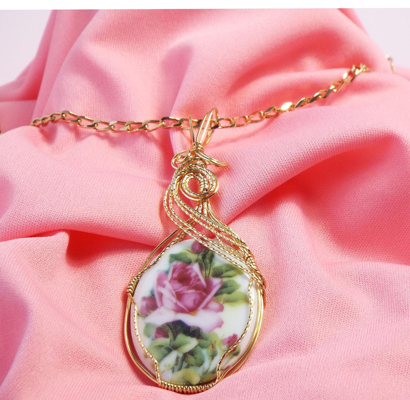 Rose pendant pink background