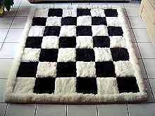 Designer alpaca fur carpet, black and white, chess design, 80 x 60 cm
