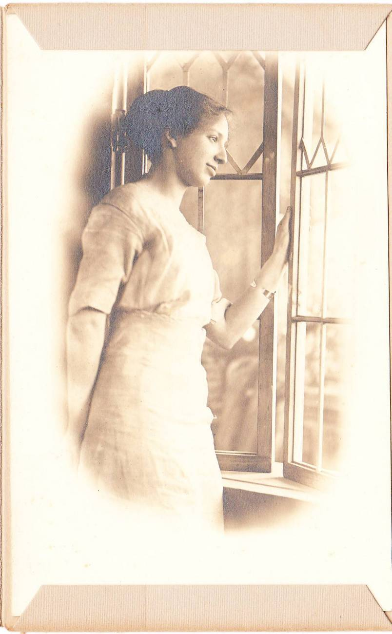 Antique photo young woman by window 1