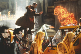 Harrison Ford in Blade Runner Leaping Above Taxis On Street 18x24 Poster - $23.99