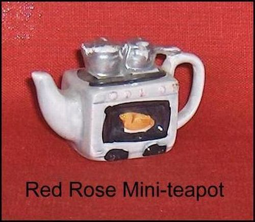 Primary image for Canadian Red Rose Tea Mini-Teapot Silver Color Stove