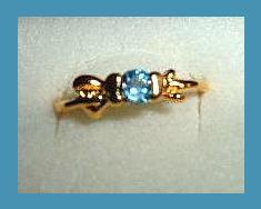 Bow Shaped 0.25ct CZ LONDON BLUE TOPAZ Yellow Gold Tone Ring