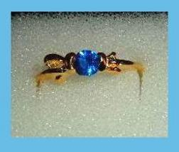 Bow Shaped 0.25ct CZ BLUE SAPPHIRE Yellow Gold Tone Ring - $24.99