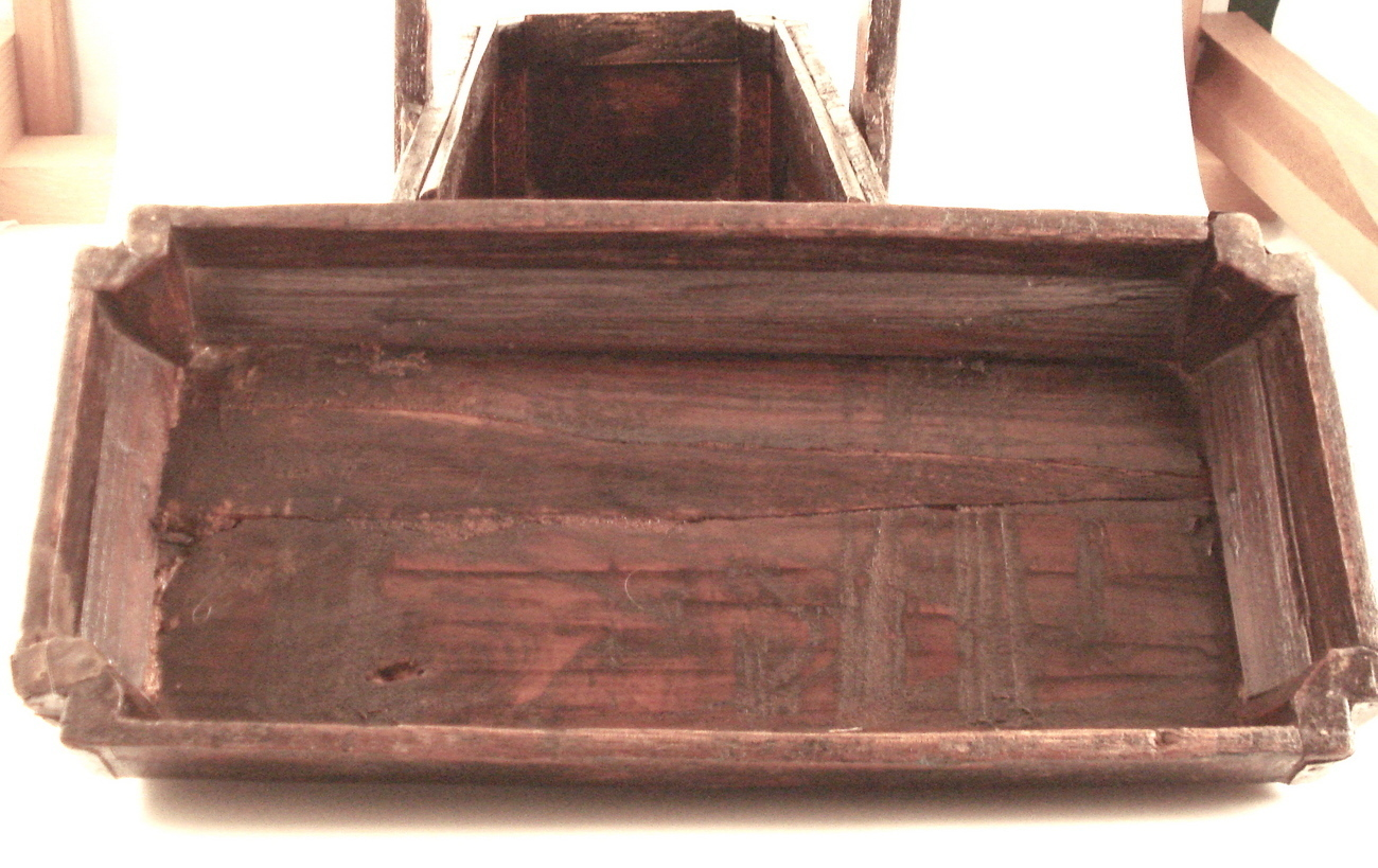 old primitive wooden box with handle and lid