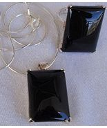 A black agate set ring and pendant - $56.00