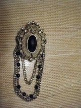 VINTAGE SILVERTONE DANGLING PIN WITH BLACK AND CRYSTAL STONES - $3.59