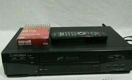 Mitsubishi HS-U466 4-Head Hi Fi VHS VCR remote and VHS tape - $49.49