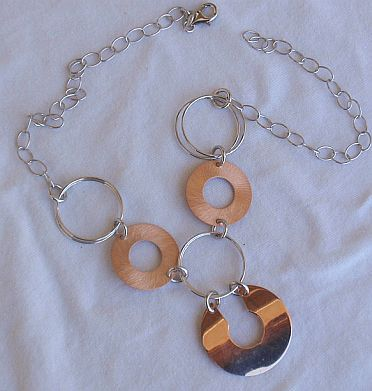 6 rounds cooper and silver necklace