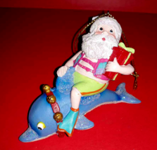 Santa Claus Riding a Dolphin Christmas Tree Ornament Ceramic Holiday Lan... - $9.60