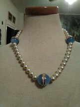 VINTAGE NECKLACE FAUX PEARL W/ LT BLUE PAVE GOLDEN SATURN RING BEAD STAT... - $35.00