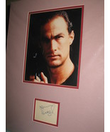 Steven Segal nicely double matted sig with color photo. Frame ready. - $48.00