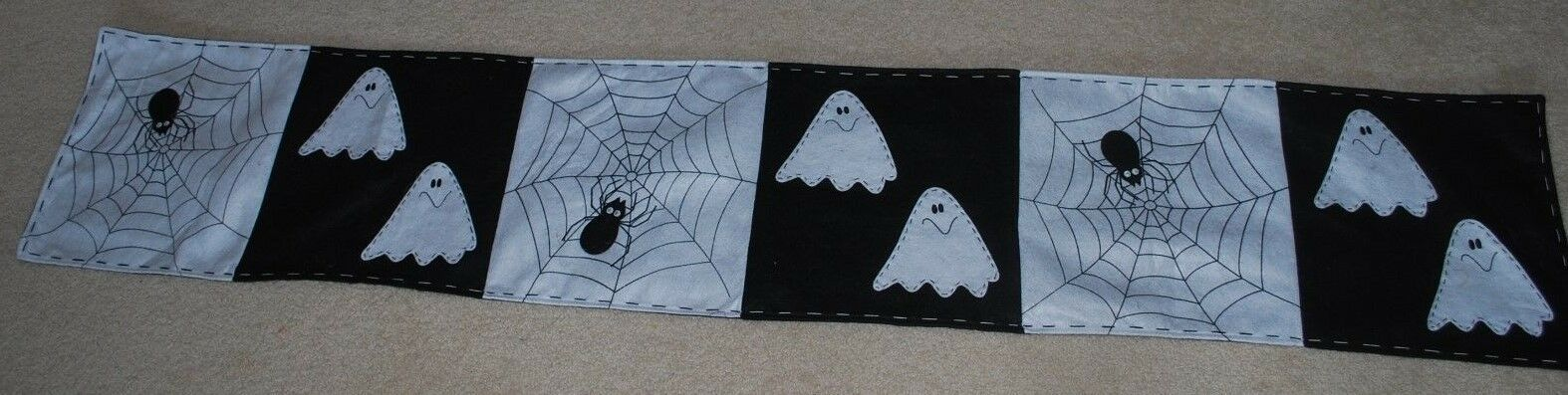 "Primary image for Halloween Fabric Table Runner Black White Ghost Spiders Cobwebs Webs 13"" X 72"""