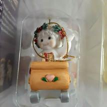 "Dreamsicles Cherub in Sled Christmas Ornament  3"" x 1 1/8"" x 1 3/4"" in box - $8.90"