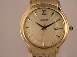Seiko classic gold tone bracelet and case sunray dial SKK672P1 - $221.30