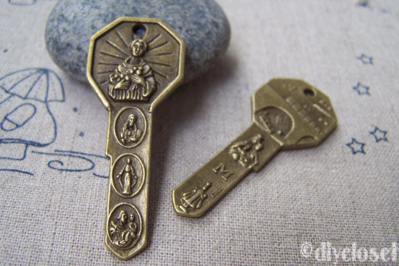 10 pcs of Antique Bronze Jesus Christ Maria Charms 20x48mm A2776