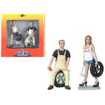 Meg and Derek Tire Brigade 2 piece Figurine Set 1/18 by Motorhead Miniat... - $34.40