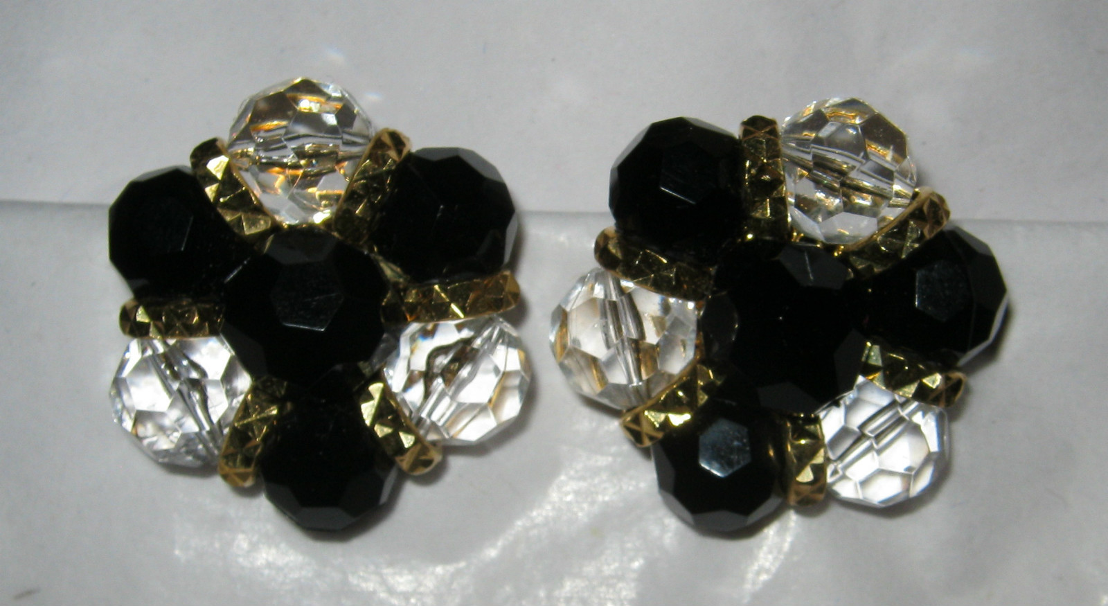 Primary image for Trifari black bead clear faceted gold tone round clip earrings MINT signed
