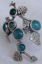 Silver flower-green - $23.00