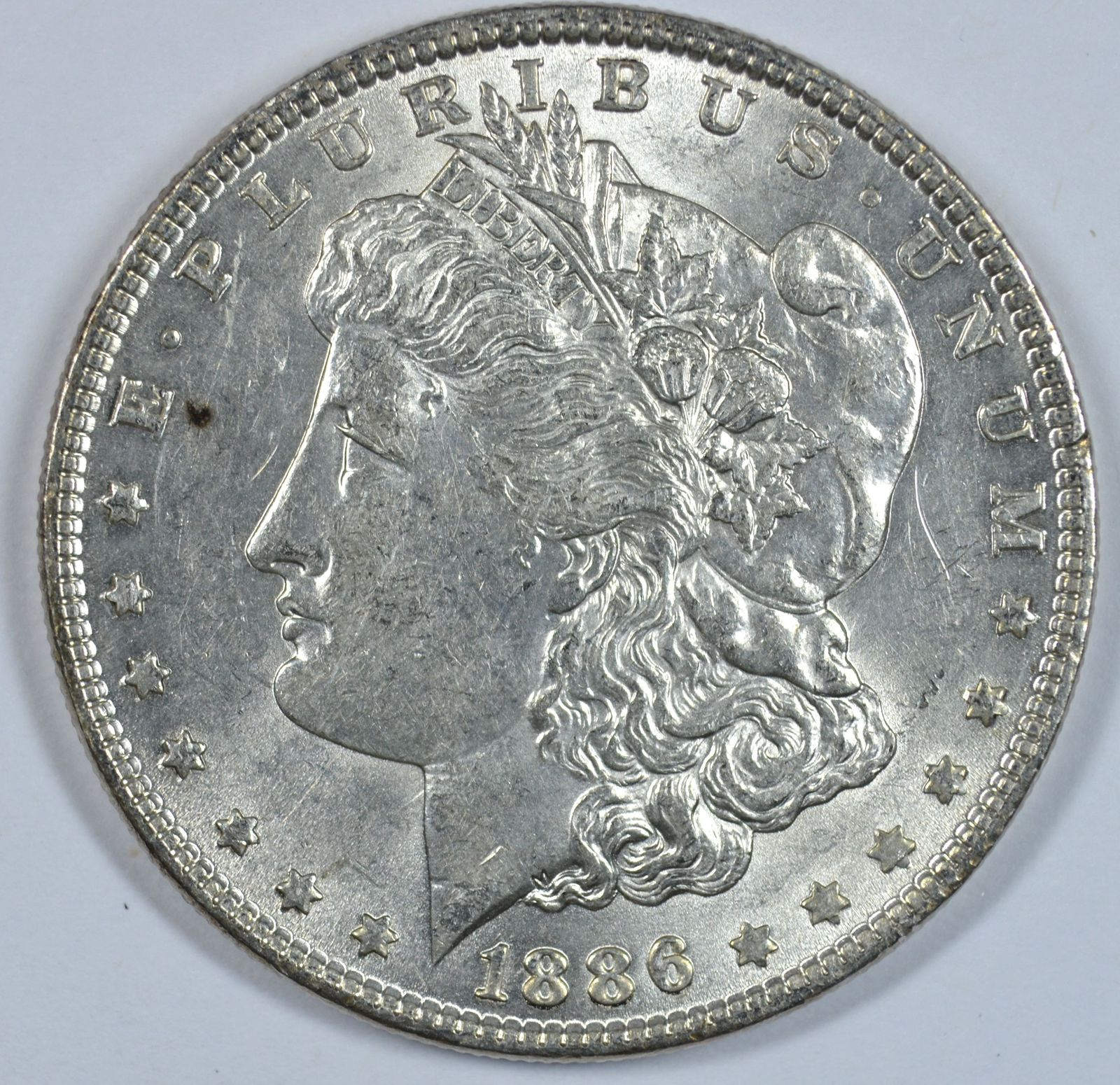 Primary image for 1886 P Morgan silver dollar AU details