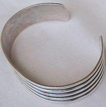 Strips silver bangle - $60.00