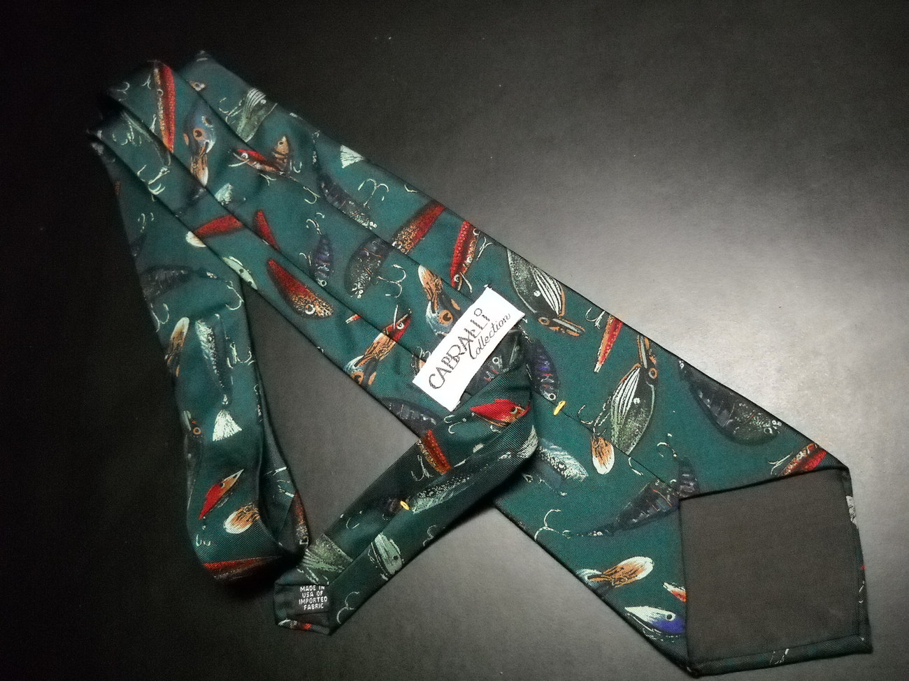 Cabralli Collection Neck Tie Repeating Fishing Lures on a Dark Green Background