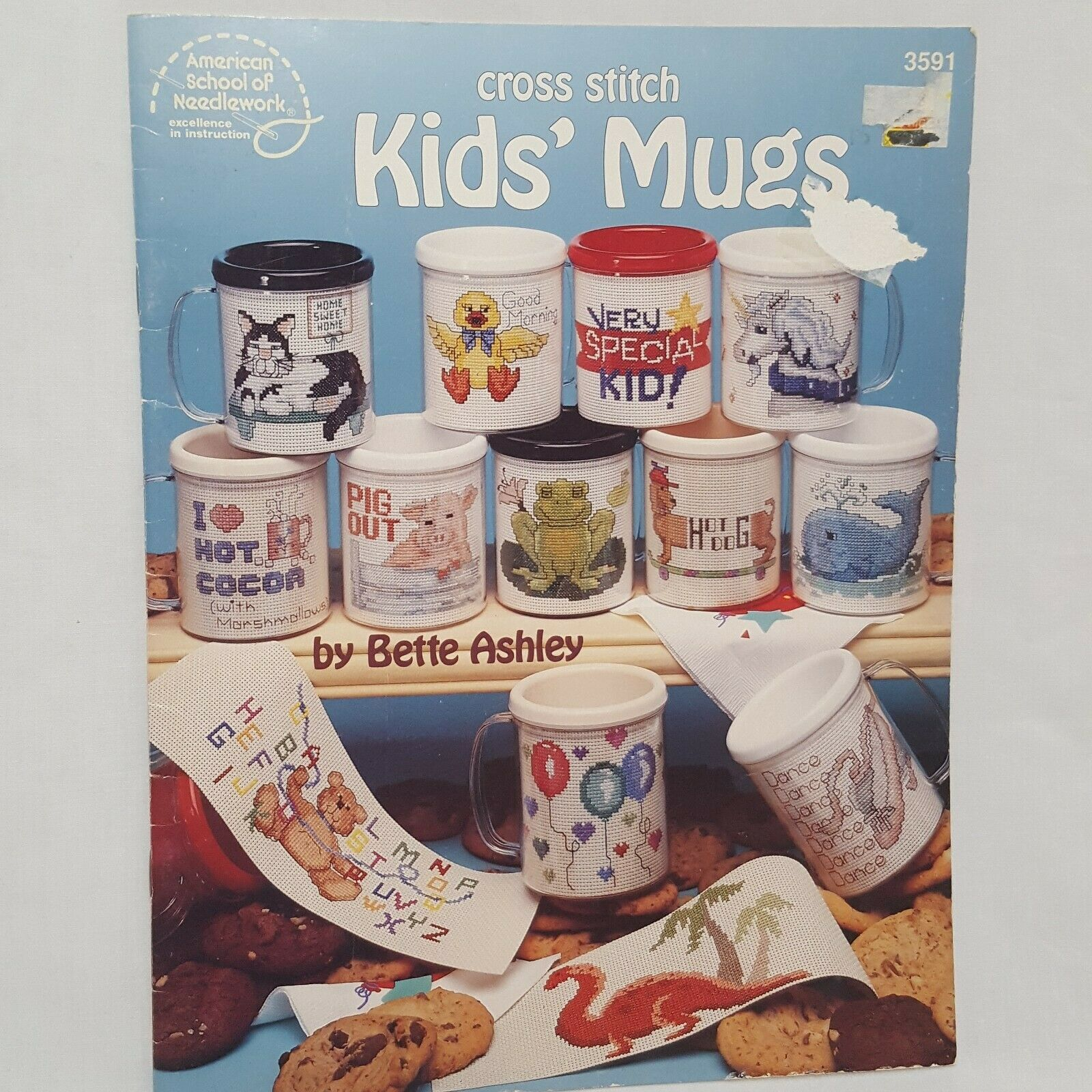 Primary image for Kids Mugs Cross Stitch Leaflet 3591 Frog Pig Unicorn Whale Cat 1992 American