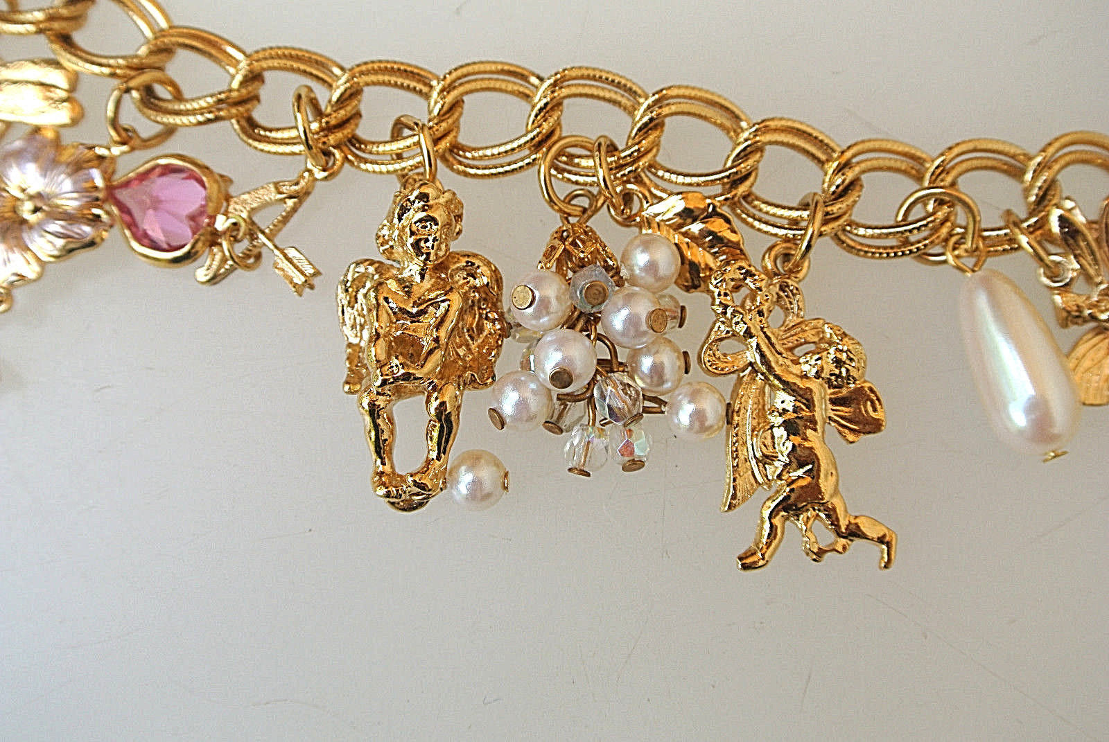 "KIRKS FOLLY Gold-tone 13 Charms BRACELET 7 1/2"" to 9""-hearts cherub angels stars"