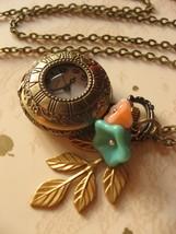 SALE - Antiqued brass garden nature pocketwatch necklace, watch necklace... - $15.99