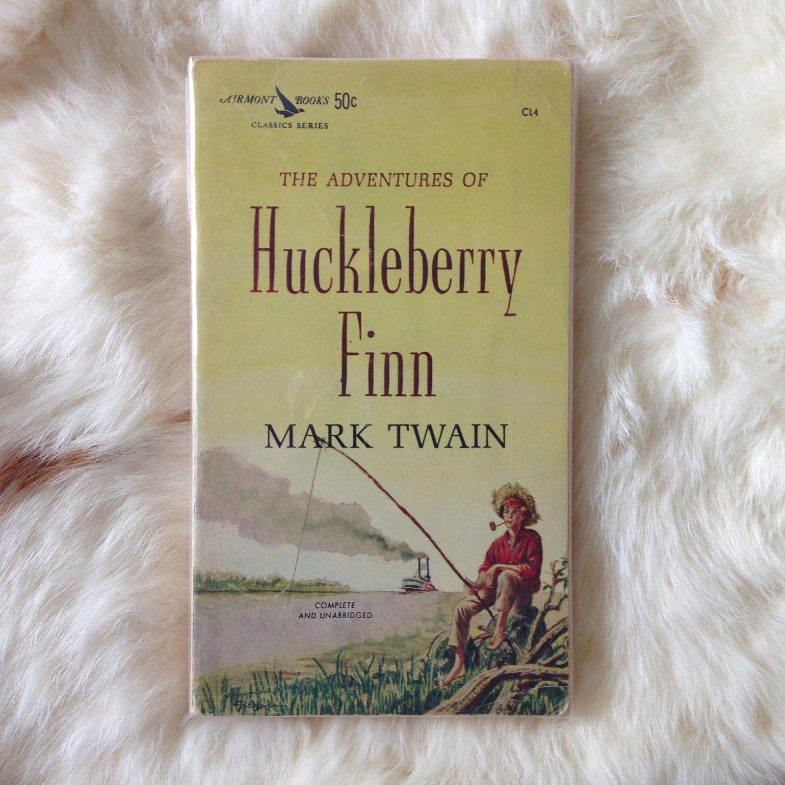 epiphany in mark twain huckleberry finn Mark twain explains his theories about writing in how to tell a story and implements them in the adventures of huckleberry finn.