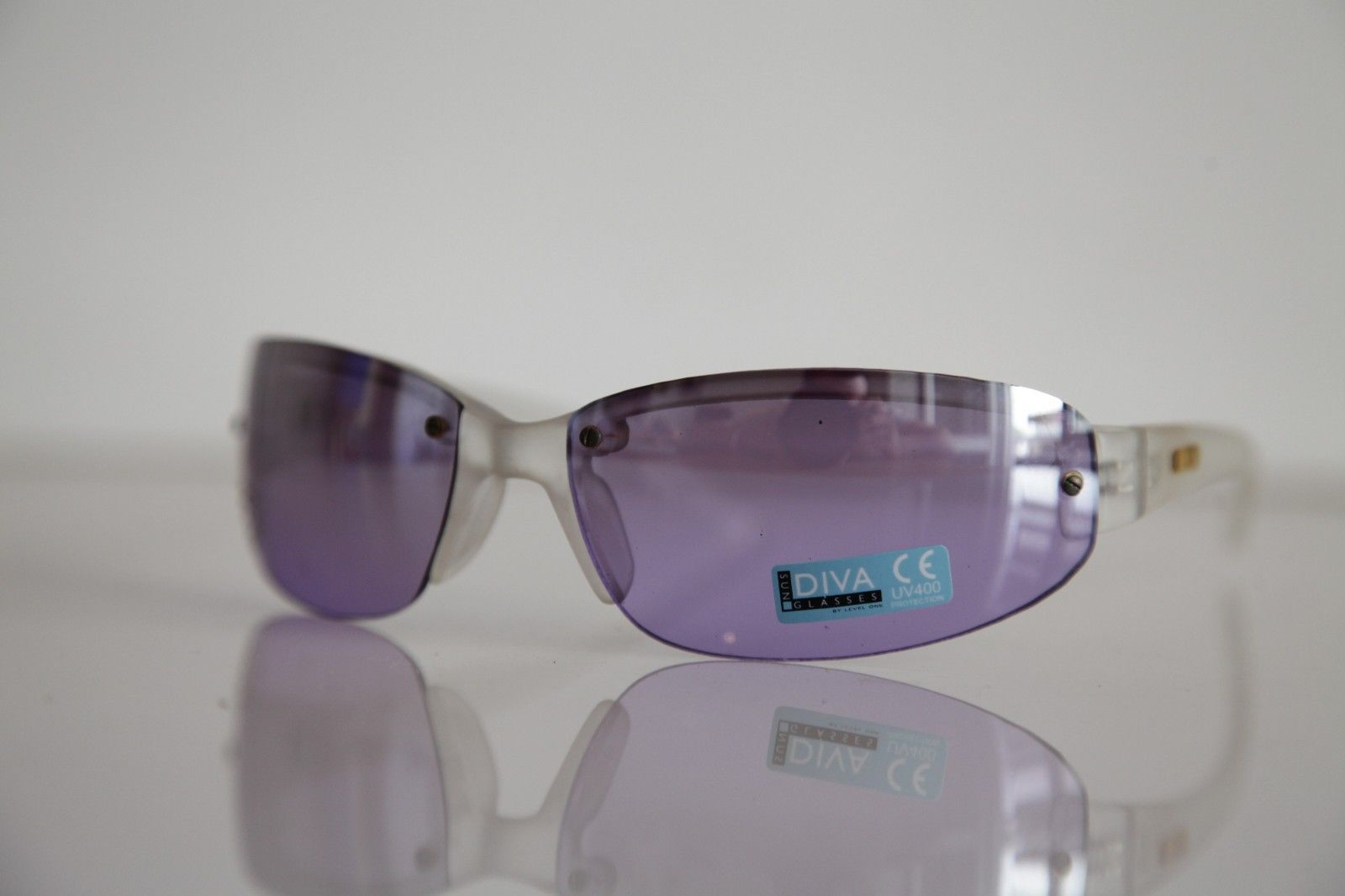 Ice White Rimless frame, Pulple lenses by LEVEL ONE ...
