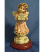 Figurine Girl Angel in Pink Dress with a Present - $9.95