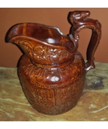 Rockingham Pottery Pitcher with Horse Head handle - $25.00