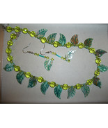 lime green faceted round crystal balls with mother of pearl leaves - $22.00